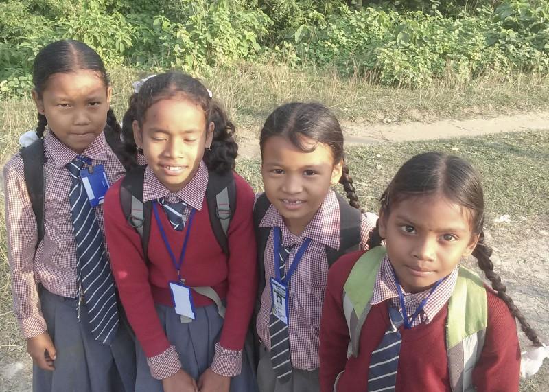Village schoolgirls on their way home.